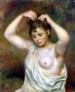 Причесывающаяся женщина