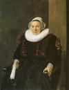 Портрет сидящей женщины с белыми перчатками