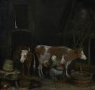 Служанка доит корову в сарае