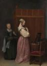 Молодая женщина за туалетом и горничная