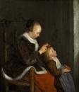Мать, расчесывающая ребенка
